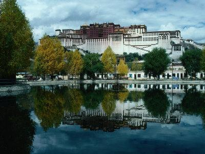 View of Impressive Potala Palace and Lake in Chingdrol Chiling (Liberation Park), Lhasa, Tibet