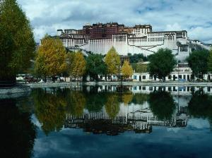 View of Impressive Potala Palace and Lake in Chingdrol Chiling (Liberation Park), Lhasa, Tibet by Richard I'Anson
