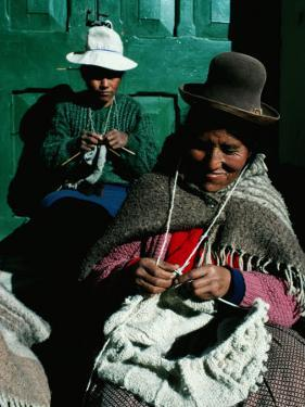 Women in Hats, Knitting Outside in the Sunshine, by a Green Wooden Door, Peru by Richard I'Anson