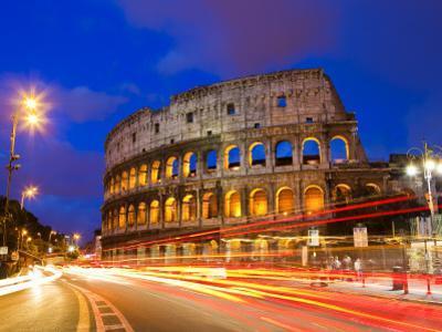 Colosseum and Traffic on Via Del Fori Imperiali by Richard l'Anson