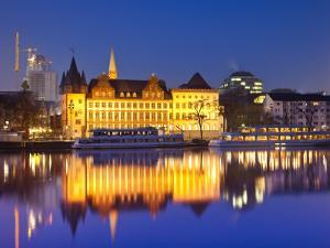 Historic Building Reflected in Main River at Dusk by Richard l'Anson