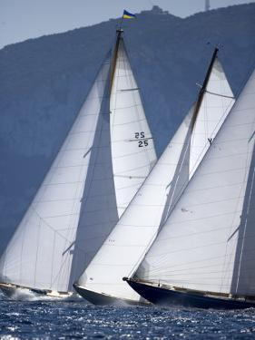 The Bows of Three Classic Yachts Racing Closely Upwind. Panerai Classics, Sardinia, September 2007 by Richard Langdon