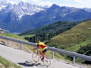 Cyclist Riding Over Sella Pass, 2244M, Dolomites, Alto Adige, Italy by Richard Nebesky