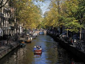 Small Boat on Tree-Lined Oudezijds Achtenburg Wal Canal in the Autumn, Amsterdam, the Netherlands by Richard Nebesky