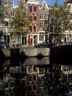 Tall Traditional Style Houses Reflected in the Water of a Canal, Amsterdam, the Netherlands by Richard Nebesky
