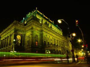 Tram Passing Neo-Renaissance National Theatre at Night, Blur, Prague, Czech Republic by Richard Nebesky