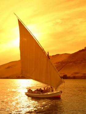 A Felucca Cruises on the Nile River at Sunset by Richard Nowitz