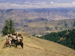 A Group of Horseback-Riding Tourists Take in the View of Hells Canyon by Richard Nowitz