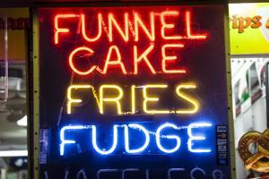 A Neon Sign on the Wildwood Boardwalk Advertising Funnel Cakes, Fries, Fudge by Richard Nowitz