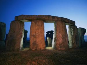 A View of Stonehenge Silhouetted by Lights at Twilight by Richard Nowitz