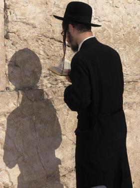 Jewish Man Prays at the Western Wall During Passover in Jerusalem, Israel by Richard Nowitz