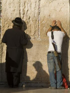 Orthodox Jew and Soldier Pray, Western Wall,Jewish Qt. Old City by Richard Nowitz