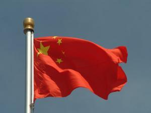 The Chinese National Flag Waves Above Tiananmen Square by Richard Nowitz