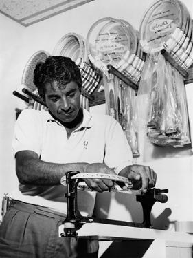 Richard 'Pancho' Gonzales Restringing a Tennis Racket in 1962