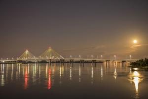 Clark Bridge at night over Mississippi River and full moon, Alton, Illinois by Richard & Susan Day