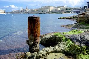 Bollard Squats on the Marsamxett Harbor of Malta Shore with Valletta by Richard Wright