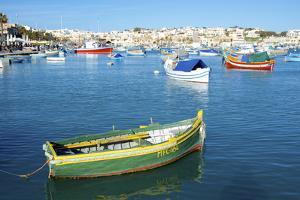 Fishermen and Luzzus in Marsaxlokk Harbor, Malta by Richard Wright