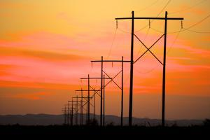 Power Lines Reach across the Desert at Sunset by Richard Wright