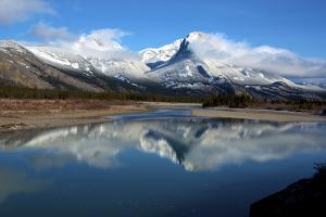 Roche Ronde Reflectsin the Athabasca River, Jasper National Park, Alberta, Canada by Richard Wright