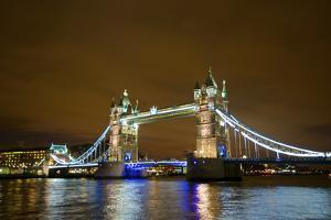 Tower Bridge on the Thames, Brightly Light at Night, London. Uk by Richard Wright