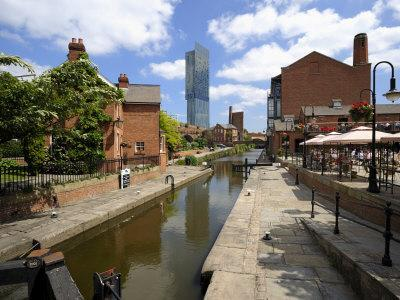 Canal and Lock Keepers Cottage at Castlefield, Manchester, England, UK