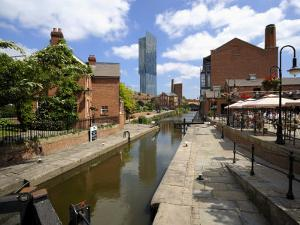 Canal and Lock Keepers Cottage at Castlefield, Manchester, England, UK by Richardson Peter