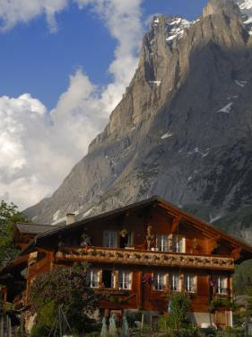Chalet and Mountains, Grindelwald, Bern, Switzerland, Europe by Richardson Peter