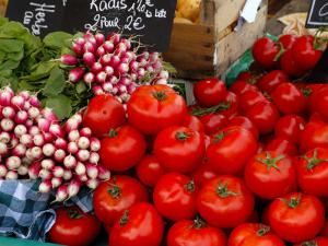 Radishes and Tomatoes on a Market Stall, France, Europe by Richardson Peter