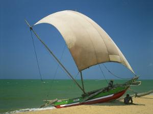 Fishermen in the Shade of a Sail on a Fishing Boat on the Beach at Negombo, Sri Lanka by Richardson Rolf