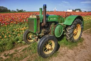 Old John Deere, Wooden Shoe Tulip Farm, Woodburn, Oregon, USA by Rick A. Brown