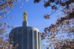 USA, Oregon, Salem, the Oregon State Capitol and Cherry Blossoms. by Rick A. Brown