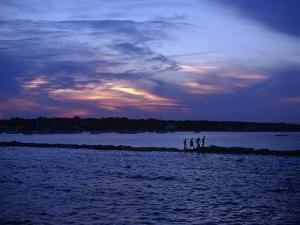People Walking by Water at Sunset, Scituate, MA by Rick Berkowitz