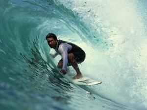 Professional Surfer Riding a Wave by Rick Doyle