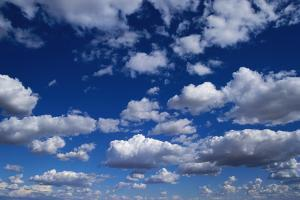 Puffy White Clouds in a Blue Sky by Rick Doyle