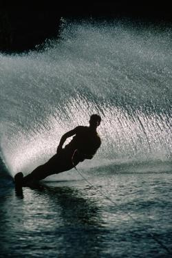Water Skier in a Slalom Turn by Rick Doyle