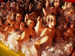Baby Jesus Dolls for Sale at Market at San Angel, Mexico City, Mexico by Rick Gerharter