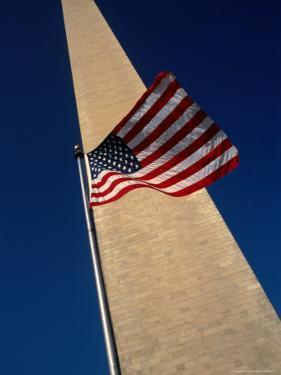 Flag and Washington Monument, Washington Dc, USA by Rick Gerharter