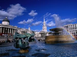Fountain in Trafalgar Square, London, Uk by Rick Gerharter