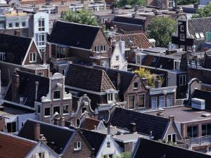 High-Pitched Roof-Tops of Houses, Amsterdam, Netherlands by Rick Gerharter