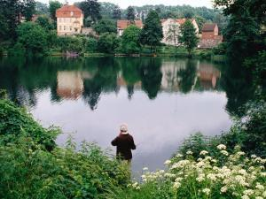 Man Fishing in Lake in In Oliwa, Gdansk, Poland by Rick Gerharter