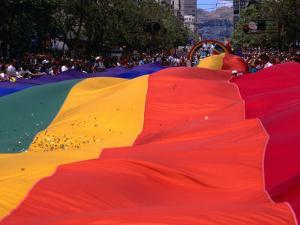 People and Banner at the Gay Day Parade, San Francisco, USA by Rick Gerharter