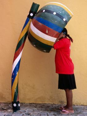Telephone Booth in Shape of Sounding Gourd of Berimbau (Capoeira Instrument) by Rick Gerharter