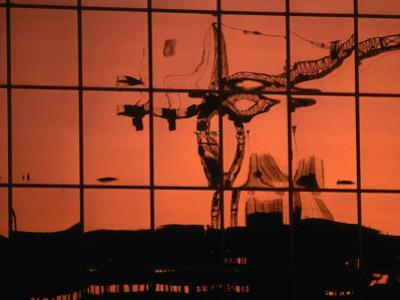 Reflection of Crane on Window, Calgary, Canada