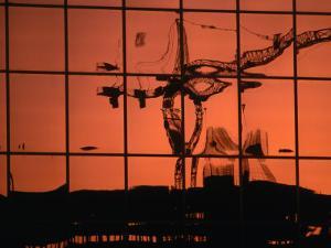 Reflection of Crane on Window, Calgary, Canada by Rick Rudnicki