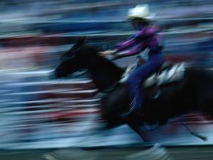 Rider in Rodeo at the Calgary Stampede, Calgary, Canada by Rick Rudnicki