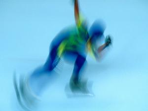 Speed Skater in Olympic Oval, Calgary, Canada by Rick Rudnicki