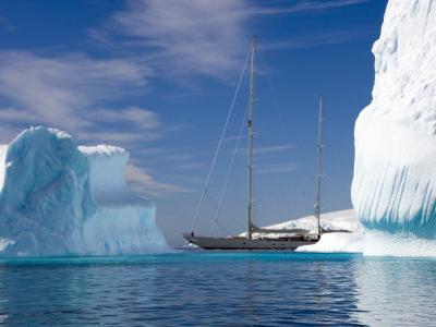 "Sy ""Adele"", 180 Foot Hoek Design, Motoring Past Icebergs in Wilhelmina Bay, Antarctica, 2007 by Rick Tomlinson"