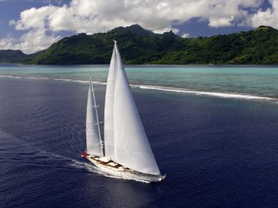 "Sy ""Adele"", 180 Foot Hoek Design, Underway Close to the Reef Off Huahine Island, French Polynesia by Rick Tomlinson"