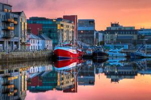 Morning View On Row Of Buildings And Fishing Boats In Docks, Hdr Image by rihardzz
