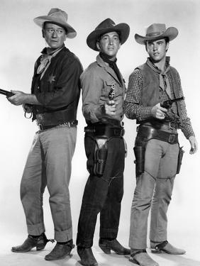 RIO BRAVO, 1959 directed by HOWARD HAWKS John Wayne, Dean Martin and Ricky Nelson (b/w photo)